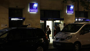 Policemen stand outside a bank in the port city of Le Havre, northwestern France, on August 6, 2020, after an armed man held several people as hostages and was finally detained. - The man entered the premises at 4:45 pm (1445 GMT), a police official told AFP, adding that officers from the elite tactical police unit RAID had been deployed.