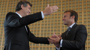 Outgoing economy minister Arnaud Montebourg hands over to his successor, Emmanuel Macron