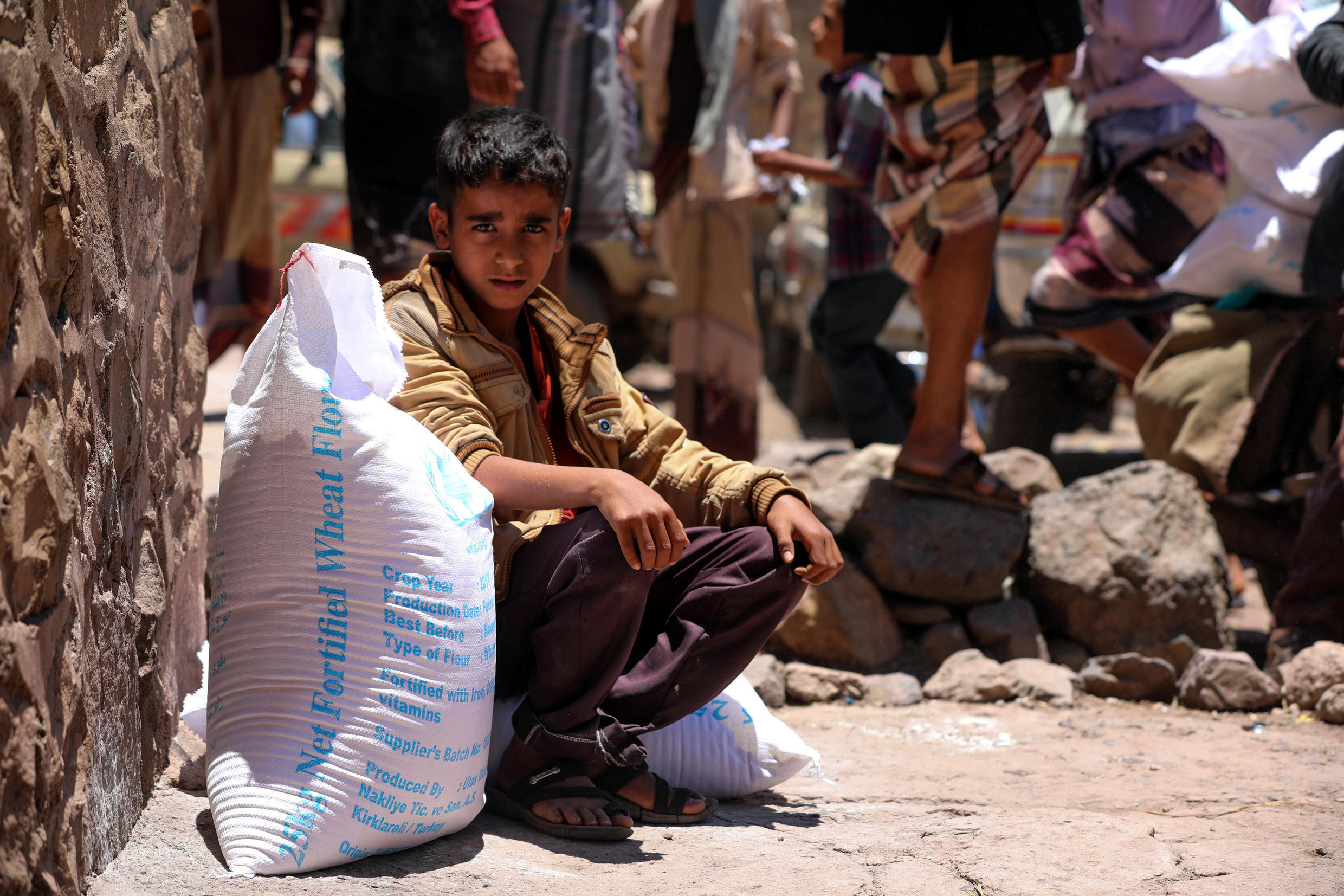 A Yemeni boy receives aid donated by the World Food Programme (WFP) in the country's third city of Taez, in October 2020 -- UN chief Antonio Guterres warns Yemen is in imminent danger of the worst famine the world has seen in decades