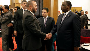 KingMohammed VI of Morocco (L) greets President of Senegal Macky Sall at the opening of the Africa Action Summit, on the sidelines of the UN Climate Change Conference 2016 (Cop22) in Marrakesh