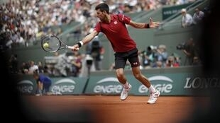 Novak Djokovic of Serbia vs Steve Darcis of Belgium
