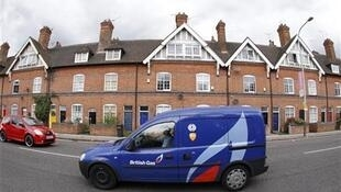A British gas van is driven through Leicester, central England