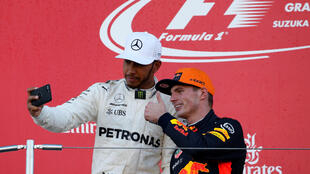 Lewis Hamilton takes a selfie photo with Red Bull's Max Verstappen after the Japanese GP.