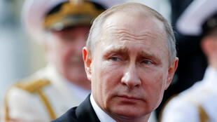 Putin attends the Navy Day parade in St. Petersburg, Russia in July