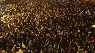 People celebrate in Diyarbakir - after Kurdish forces took full control of the Syrian town of Kobane, 26 January 2015.