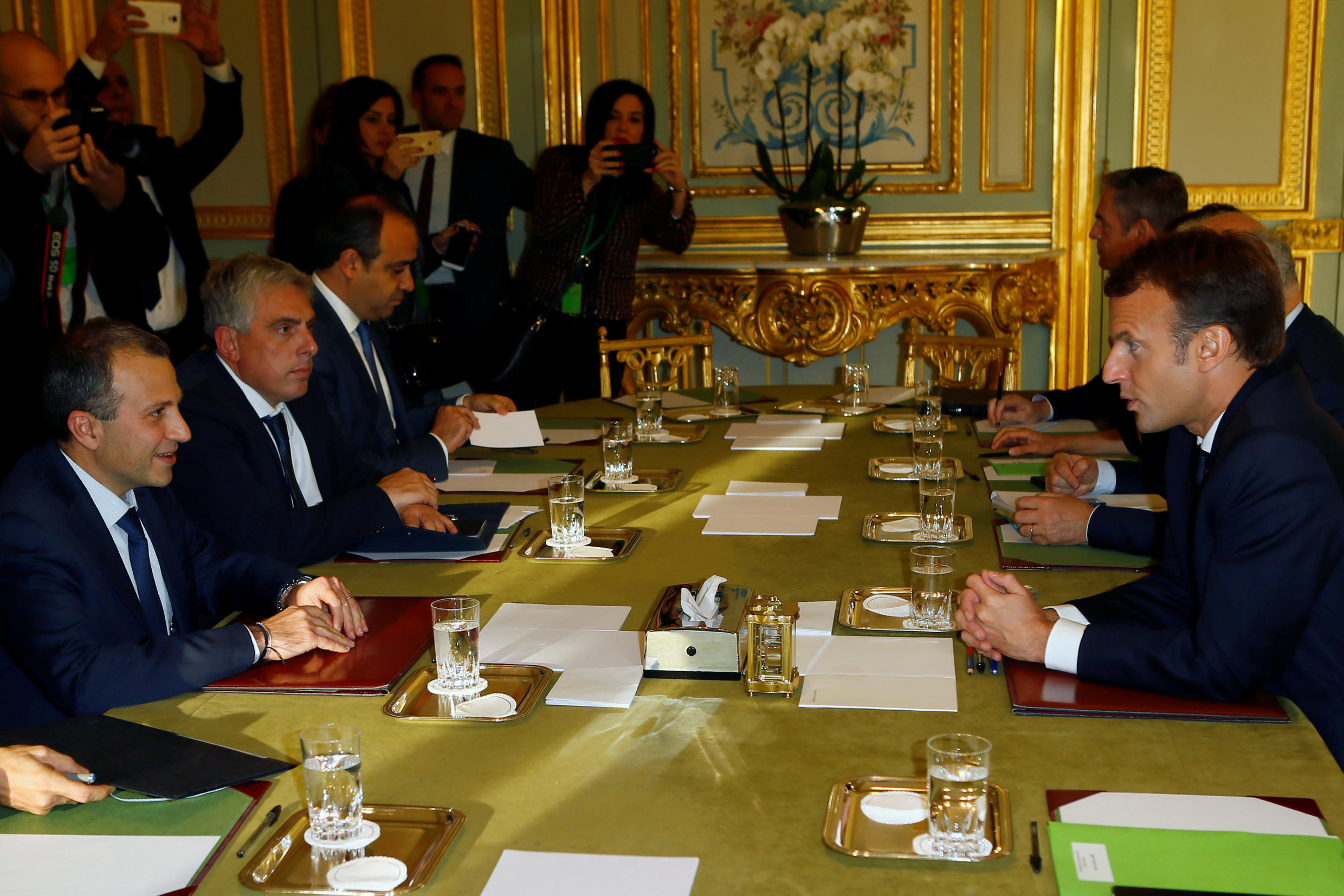 President Emmanuel Macron (R) with Lebanese Foreign Affairs Minister Gebran Bassil (L) at the Elysée on Tuesday