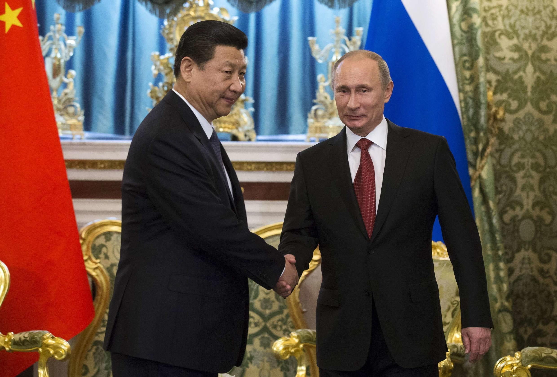 El presidente chino Xi Jinping y su par ruso Vladimir Putin, este 22 de marzo de 2013 en Moscú.