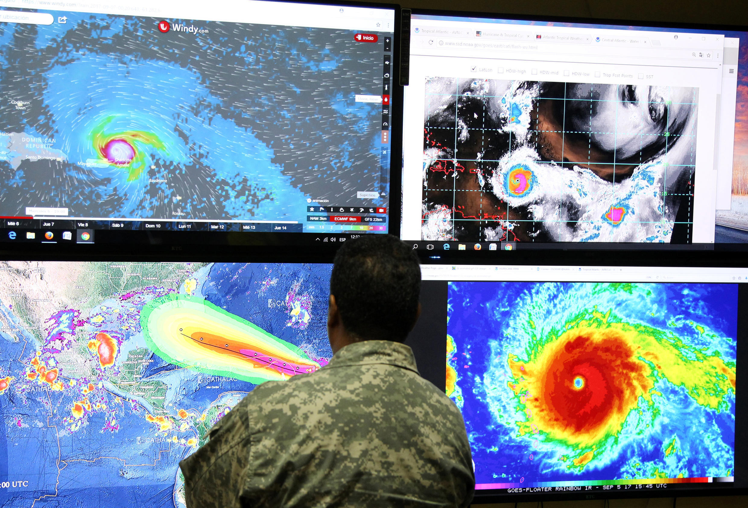A member of the Emergency Operations Committee (COE) monitors the trajectory of Hurricane Irma in Santo Domingo, Dominican Republic September 5, 2017.