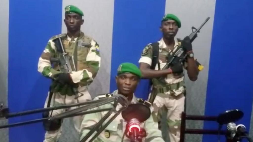 Coup plotters read their statement on Gabonese radio and television.