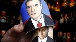 Traditional Russian doll bearing the faces of Russian Prime Minister Vladimir Putin (underneath) and President Dmitry Medvedev