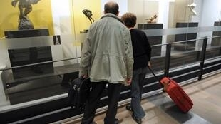 Passengers looking at works by Auguste Rodin at the first art exhibition held at Roissy-Charles de Gaulle Airport (ADP), January 201513