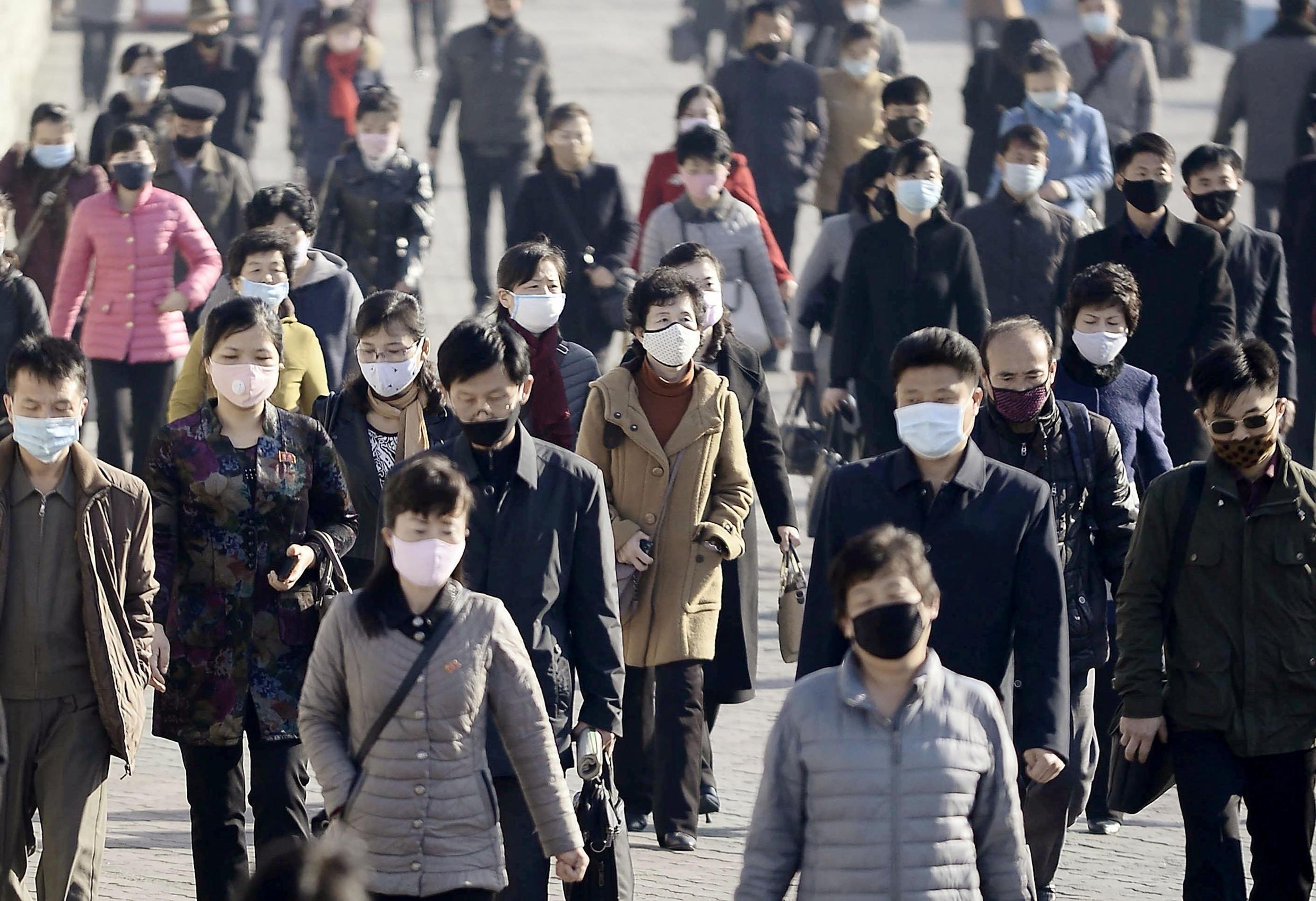 People wearing protective face masks commute amid concerns over the new coronavirus disease (COVID-19) in Pyongyang, North Korea March 30, 2020, in this photo released by Kyodo. Picture taken March 30, 2020.