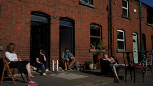 Neighbours in Dublin chat while observing rules on social distancing during the coronavirus pandemic.