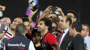 Le joueur égyptien Mohamed Salah photographié en marge de l'entraînement de son équipe, le 9 juin 2018 au Caire.