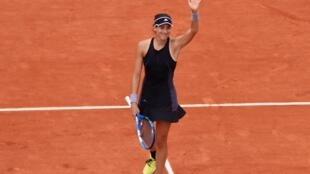 Garbine Muguruza registered her first victory over Maria Sharapova in four attempts.