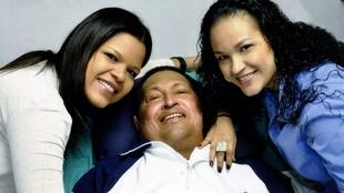 Hugo Chavez with his two daughters in hospital in Havana earlier this year
