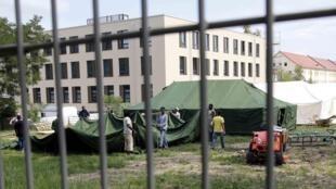 Des demandeurs d'asile dans un centre d'accueil à Eisenhuettenstadt, en Allemagne, ce mercredi 22 juillet.