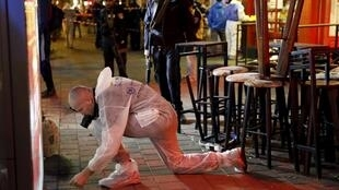 An Israeli forensic policeman works at the scene of a shooting incident in Tel Aviv, Israel January 1, 2016.