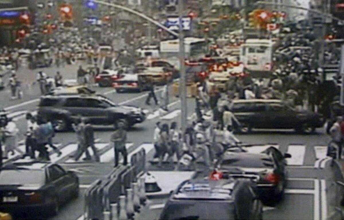 A surveillance photo of Times Square shows a Nissan Pathfinder sports utility vehicle (R) containing a bomb