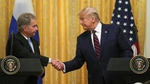 US President Donald Trump and Finland's President Sauli Niinisto share a wilting handshake during a joint news conference in Washington DC, U.S., 2 October, 2019.