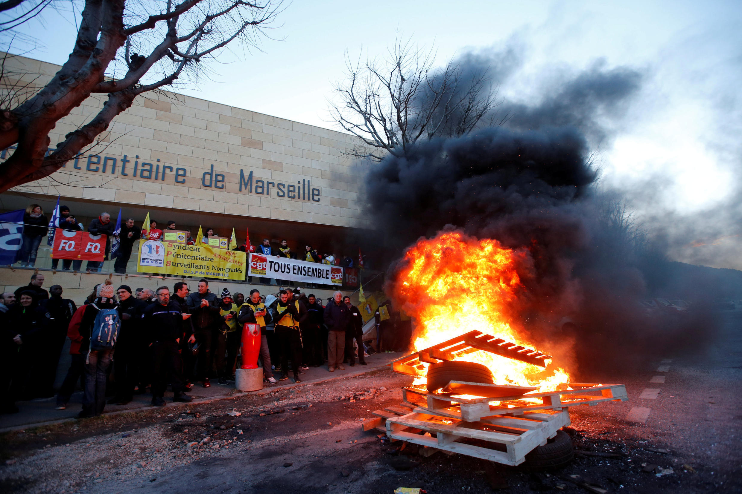 Strikers outside the Baumettes jail in Marseille on Monday