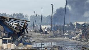 """A view shows the charred debris from makeshift shelters and tents in the """"Jungle"""" on the third day of the evacuation of migrants, as part of the dismantlement of the camp in Calais."""