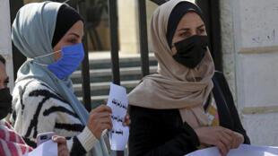 Manifestation contre la décision interdisant aux femmes d'entrer et de sortir de la bande de Gaza sans la permission de son «tuteur», le 16 février 2021.