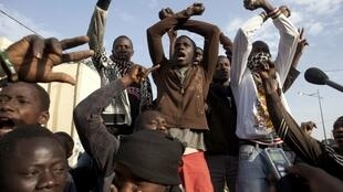 "Members of Senegalese anti-government youth movement Y'en a marre, or ""We're Fed Up,"" chant slogans in Senegal's capital Dakar"