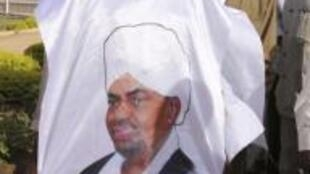 A Sudanese man wears a tunic with the face of Sudan's President Omar Hassan al-Beshir