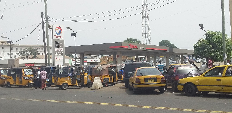 Customers queue for petrol in Monrovia, Liberia amid shortages, February 2020.