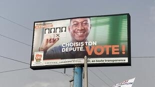 IMAGE Une affiche de la Commission électorale pour les législatives du 6 mars 2021 en Côte d'Ivoire. 06/03/2021