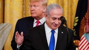U.S. President Donald Trump pats Israel's Prime Minister Benjamin Netanyahu as they deliver joint remarks to discuss a Middle East peace plan proposal in the East Room of the White House in Washington, U.S., January 28, 2020.