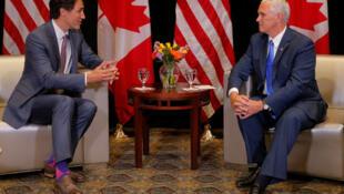 彭斯(右)和加总理会面 讨论华为和贸易等议题  路透社资料