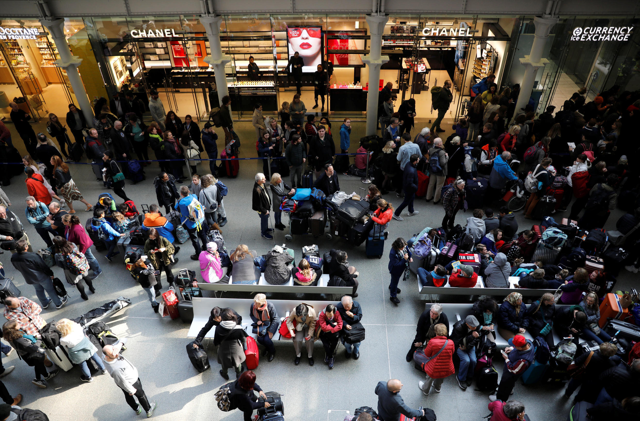 People wait due to Eurostar delays at St Pancras International railway station in London, UK, 30 March 2019.