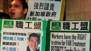 labour union activists protest outside their offices Singapore Consulate in Hong Kong  December 5, 2012.