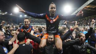'Yan wasan kungiyar  Montpellier, a lokacin da suke murnan lashe kofin league na Faransa
