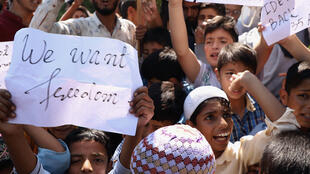 Kashmiris shout anti-India slogans during a protest against the imposition of direct rule.