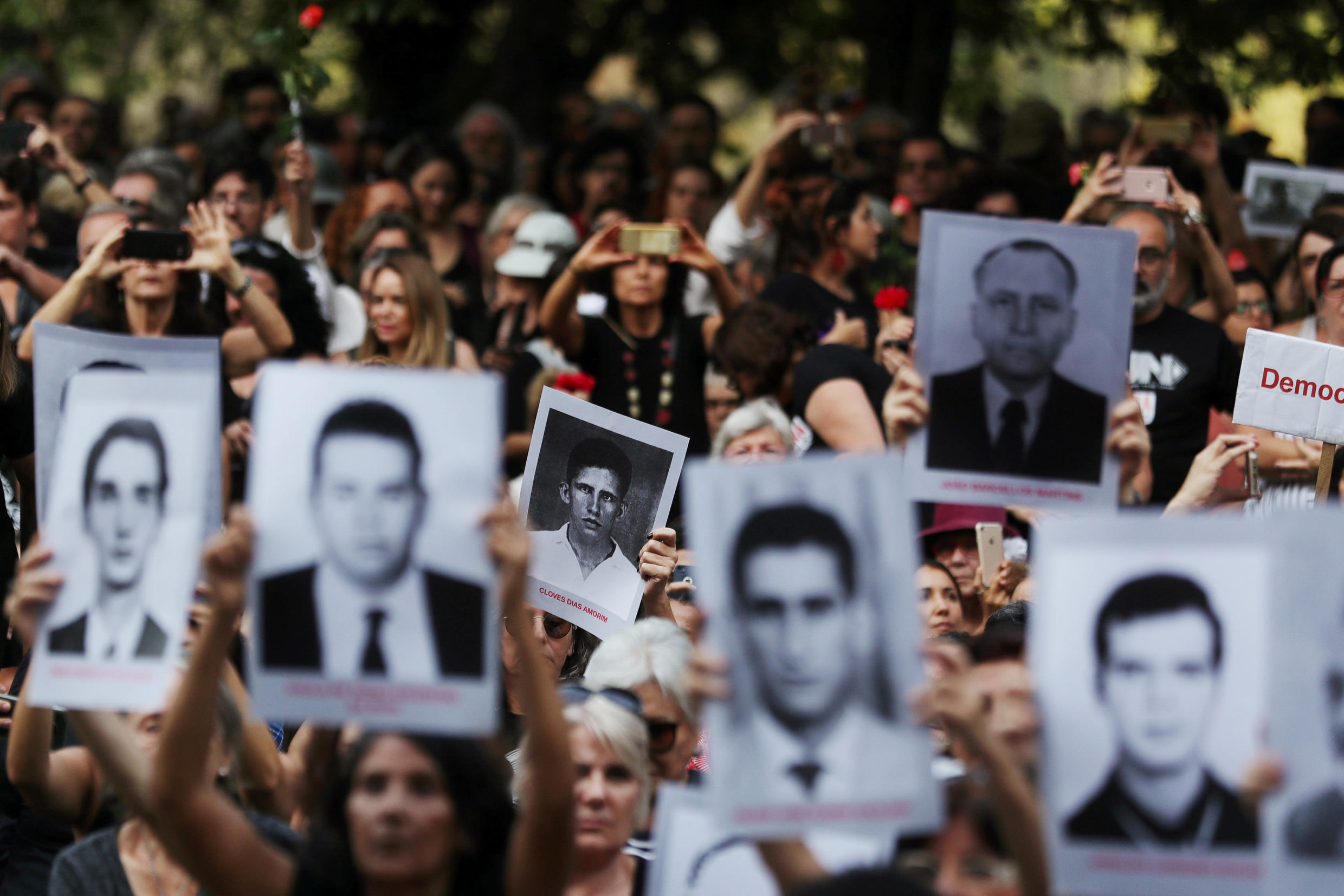 Demonstrators hold pictures of victims of dictatorship, Sao Paulo, March 31, 2019