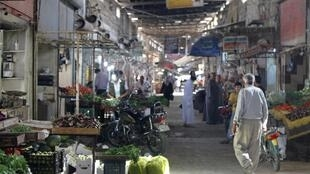 People buy their goods and fruits from the Souk in Azaz, 7 October, 2012