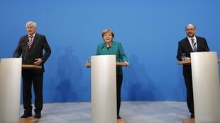 CDU) leader and German Chancellor Angela Merkel, Christian Social Union (CSU) leader Horst Seehofer and Social Democratic Party (SPD) leader Martin Schulz give a statement after coalition talks to form a new coalition government in Berlin, Germany, Februar