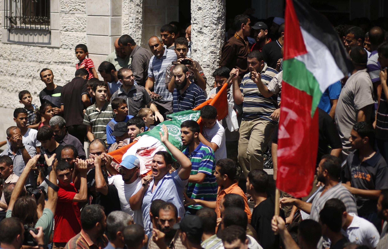 Похороны жены одного из лидеров ХАМАСа Мухаммеда Деифа и его сына, сектор Газа, 20 августа 2014 г.