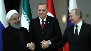 Presidente do Irão, Hassan Rohani, Presidente da Turquia, Recep Tayyip Erdogan, e Presidente da Rússia, Vladimir Putin. Ancara, Turquia. 4 de Abril de 2018.