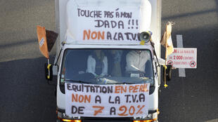 Lorry in convoy protesting against VAT increase, Monday 02 Dec. outside Paris