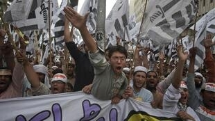Islamists protest at the attack on a demo in Karachi