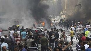 Civil Defence workers, Hezbollah members, police and civilians at the site of the Beirut blast