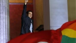 Alexis Tsipras waves to supporters after winning the elections in Athens, 25 January 2015.