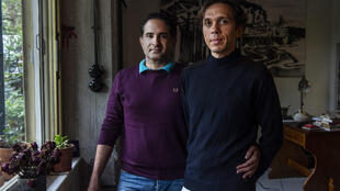 Greek national Alexandros Massavetas (left) and Cihan Tutluoglu of Turkey are pictured in their Athens home
