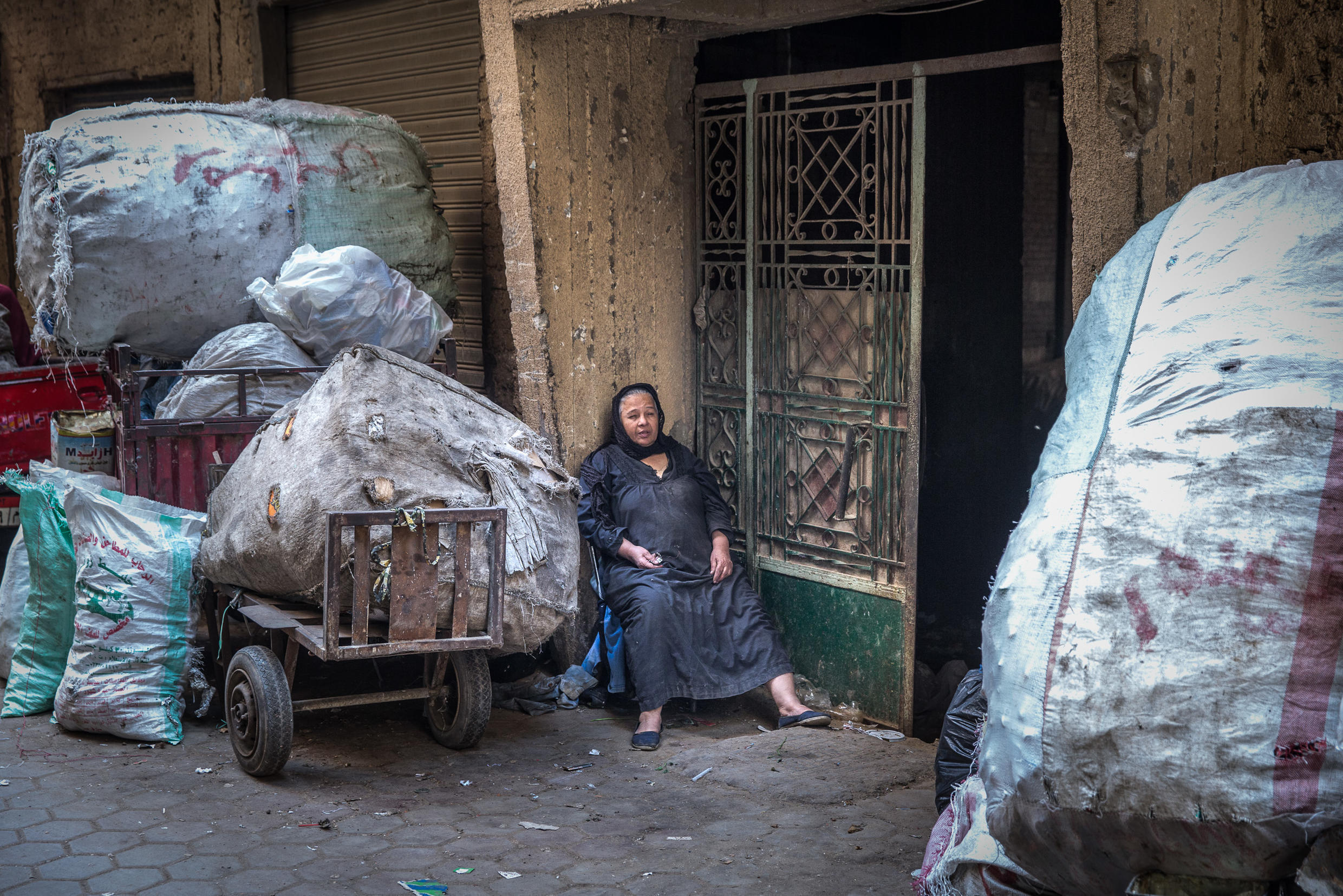Woman takes a break from sorting garbage