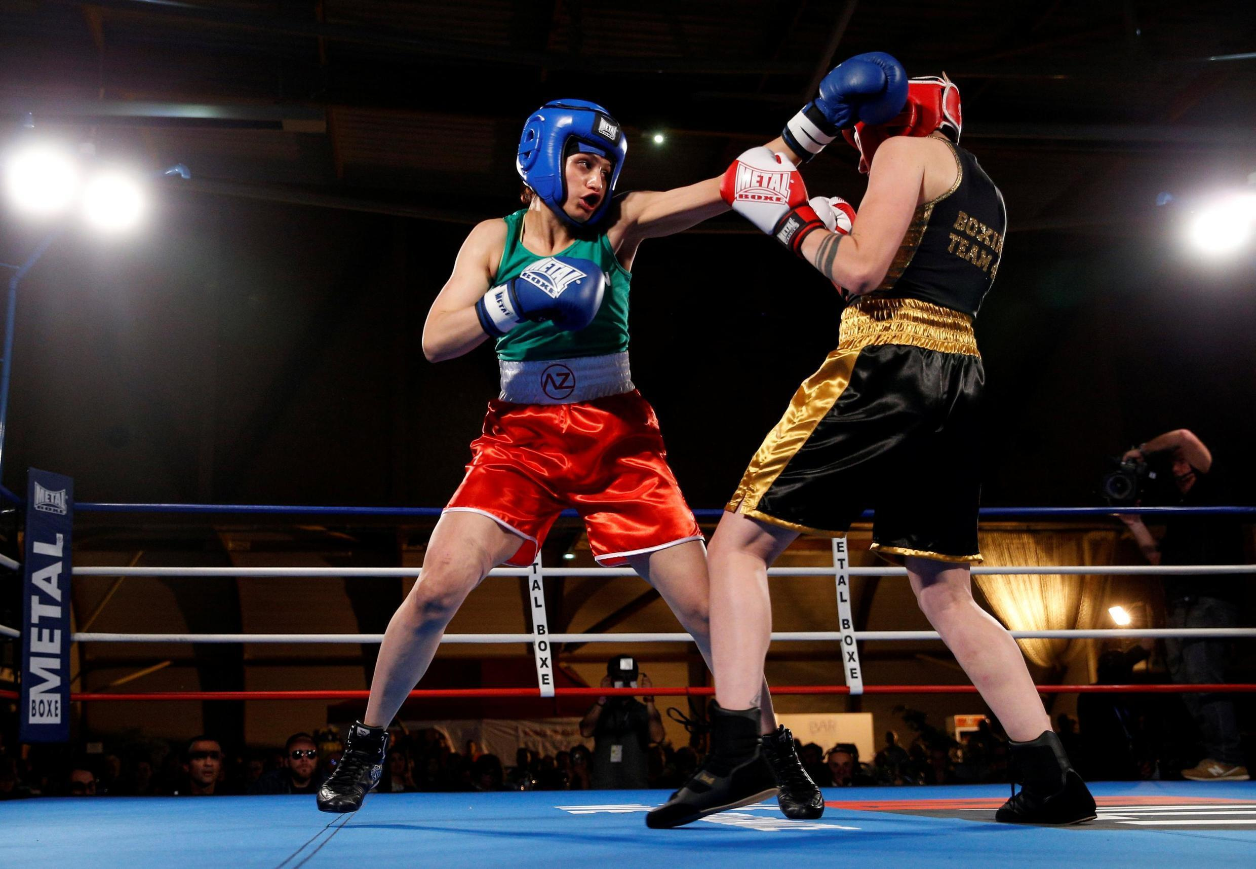 Iranian boxer Sadaf Khadem in action against French boxer Anne Chauvin during an official boxing bout in Royan, France, April 13, 2019.