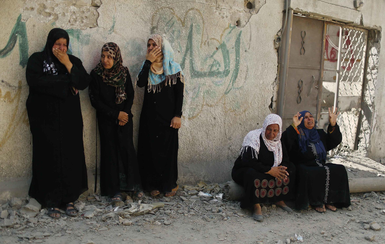 Жительницы сектора Газа вернулись в свои разрушенные дома, 26 июля 2014 г.